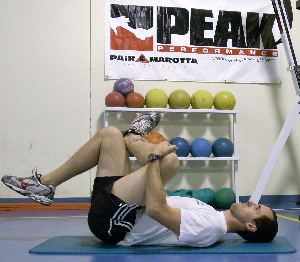 One way to keep your back flat during the Figure 4 stretch.